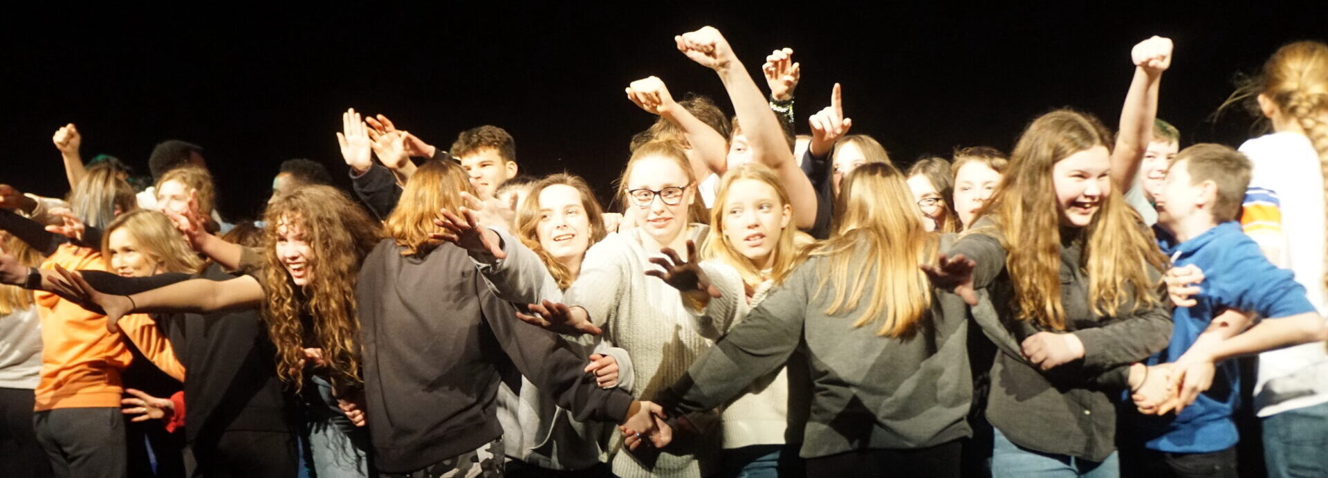 Young people raising thieir fists at a northcott performance