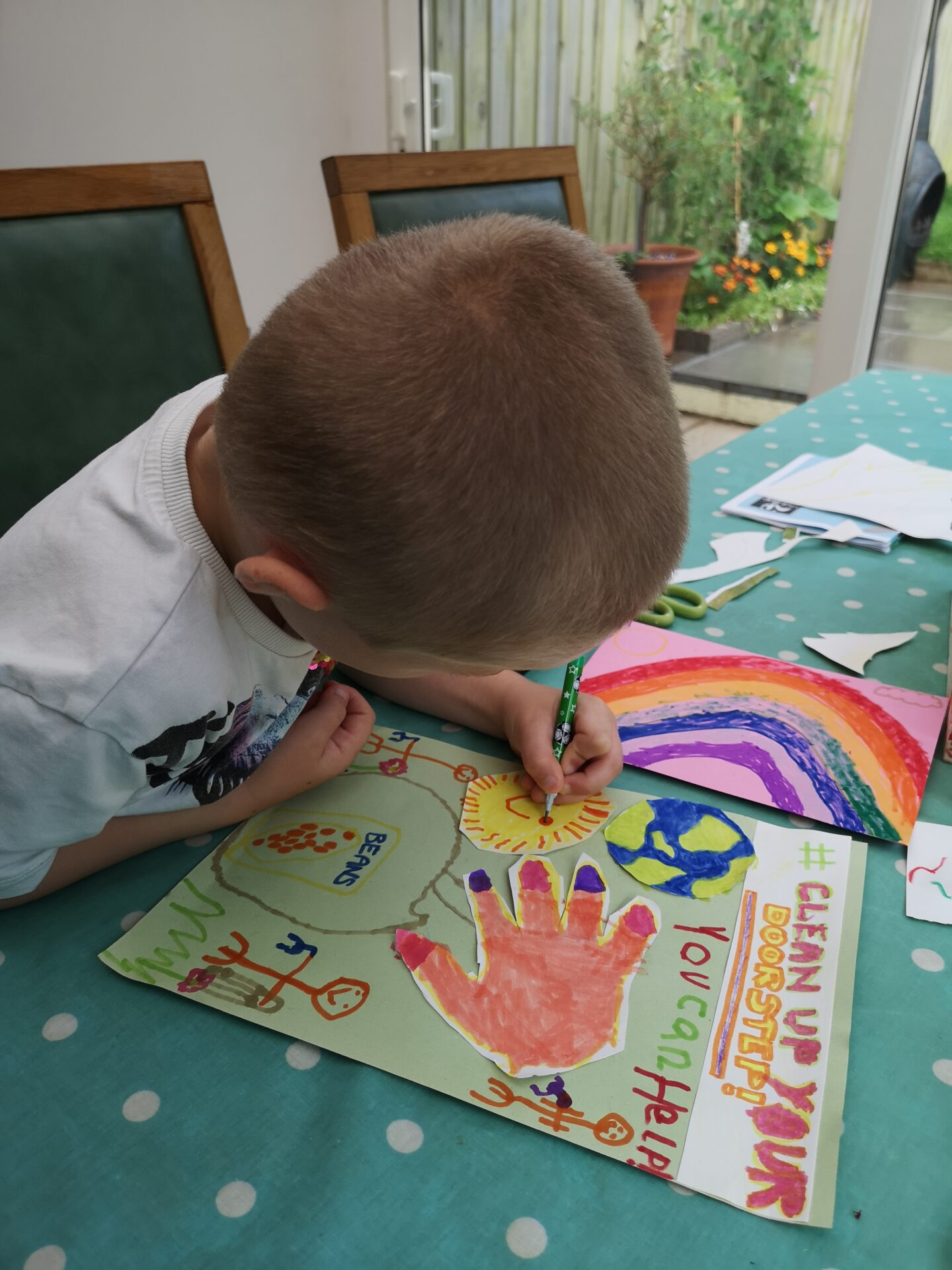 small child colouring a poster